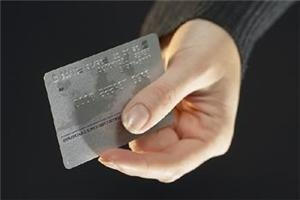 Americans played a larger part in their improved credit card standings than previously thought.
